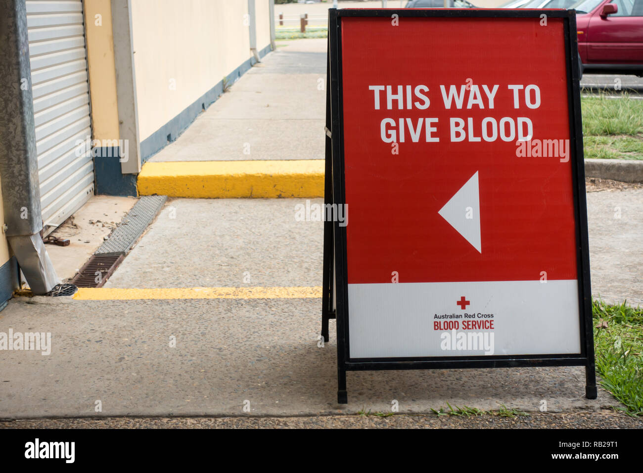 Blood Donor entry sign 'This Way to Give Blood' - Stock Image