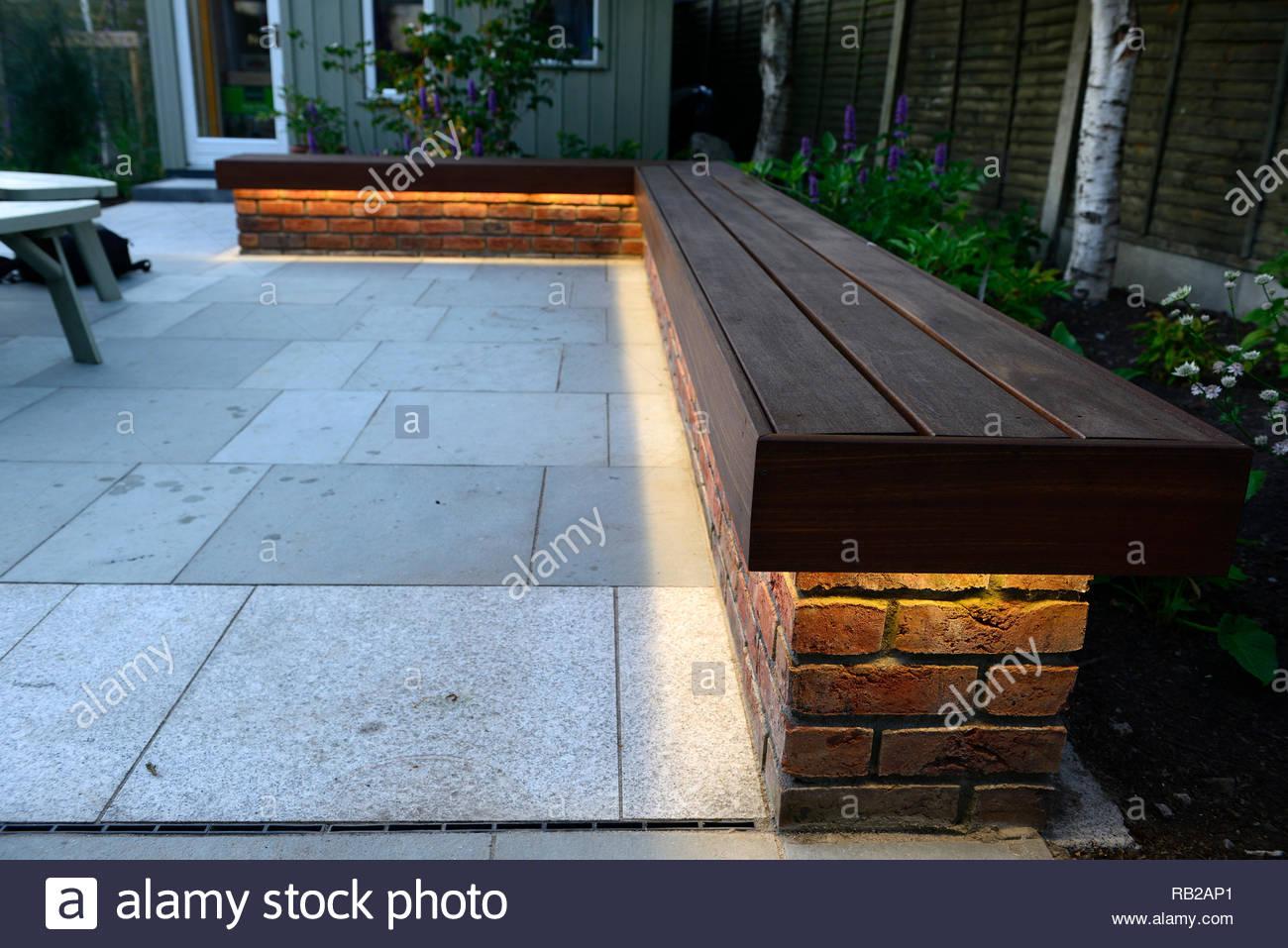 redbrick seating,wooden seating,downlight,downlighting,illuminate,illuminated,evening,dusk,patio feature,garden feature,small garden,gardens,RM Floral - Stock Image