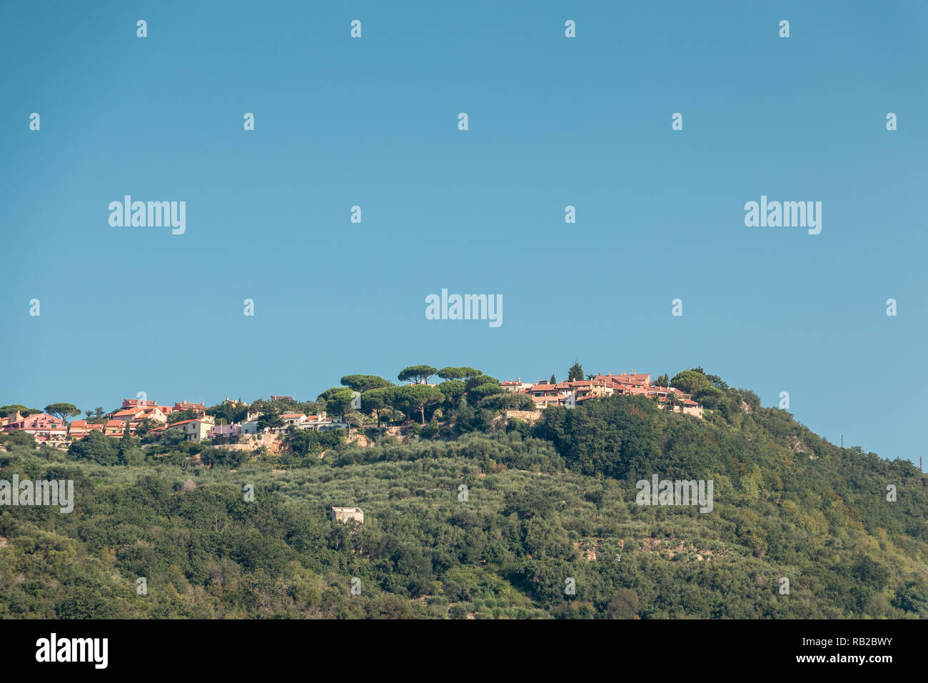A small Italian village with green forest Stock Photo