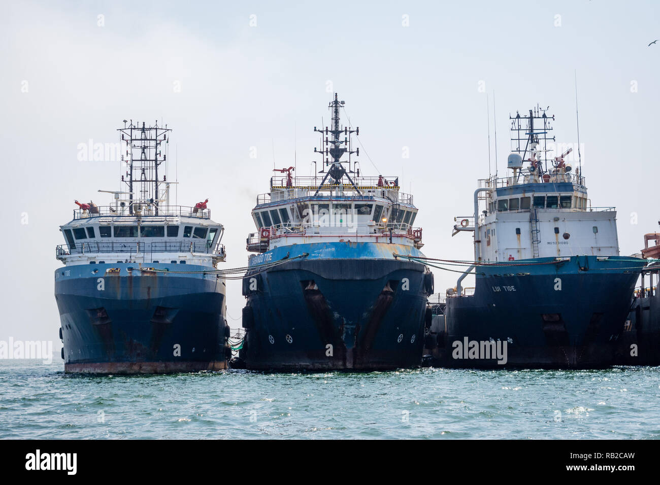 cargo ships moored, Walvis Bay, Namibia - Stock Image
