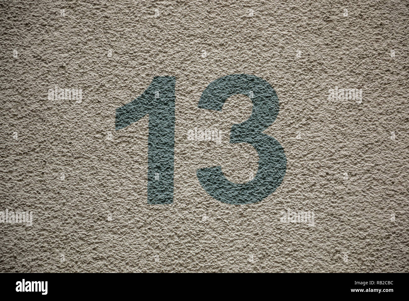 Number 13 of the house with green letters Stock Photo