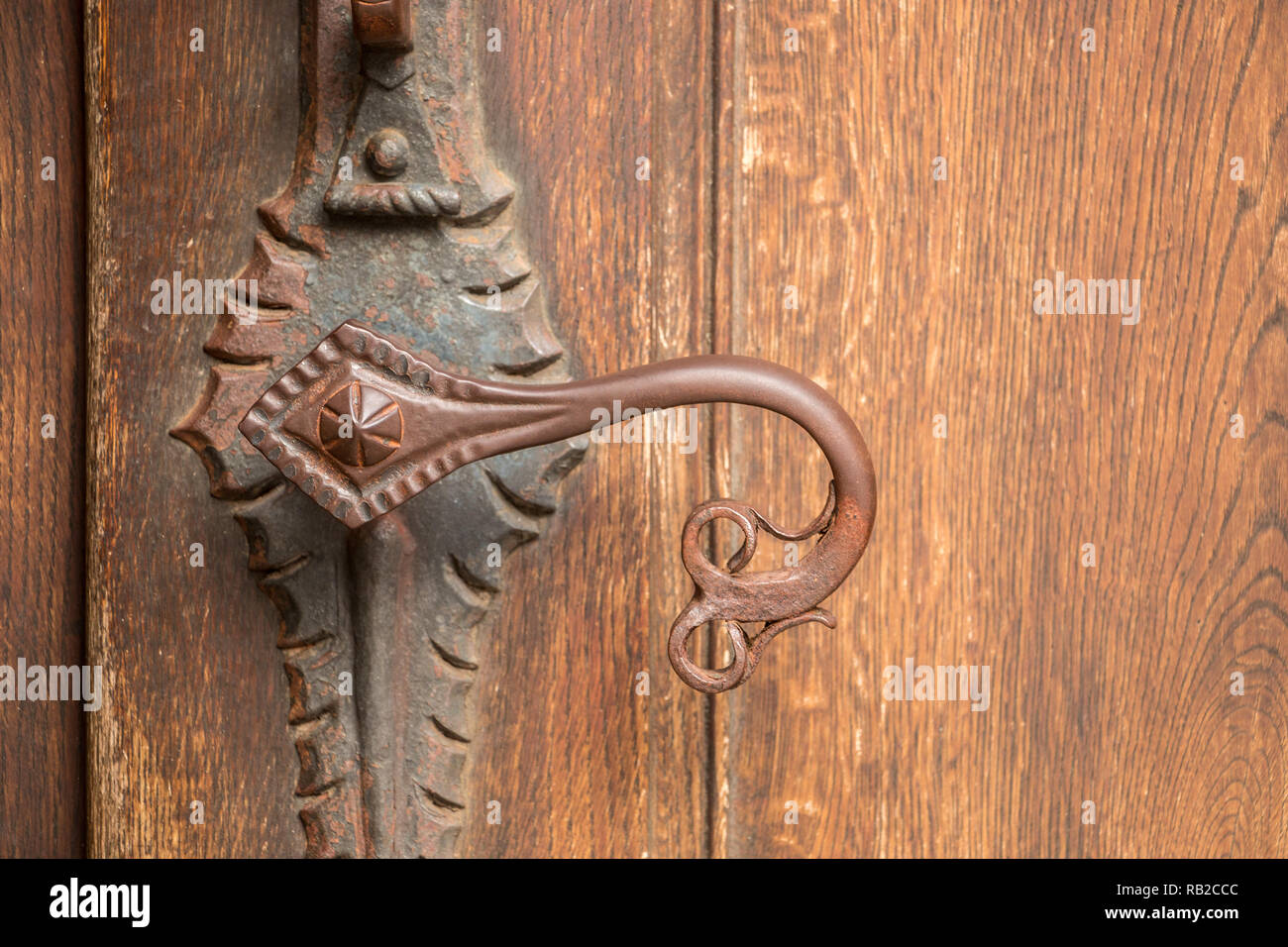 Door handle of an old historical building made of iron - Stock Image