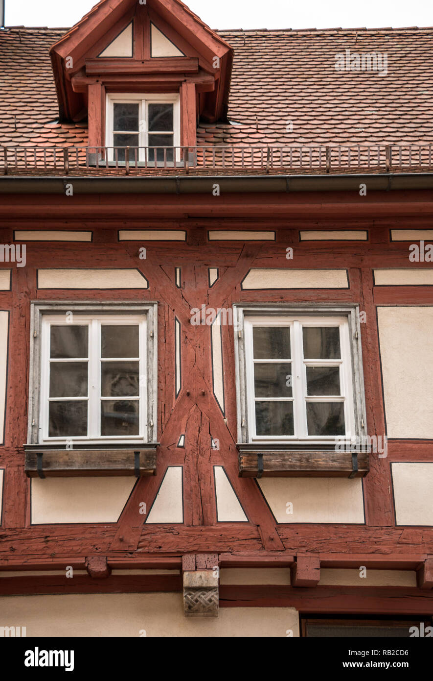 Old historical building and half-timber house with red wood - Stock Image