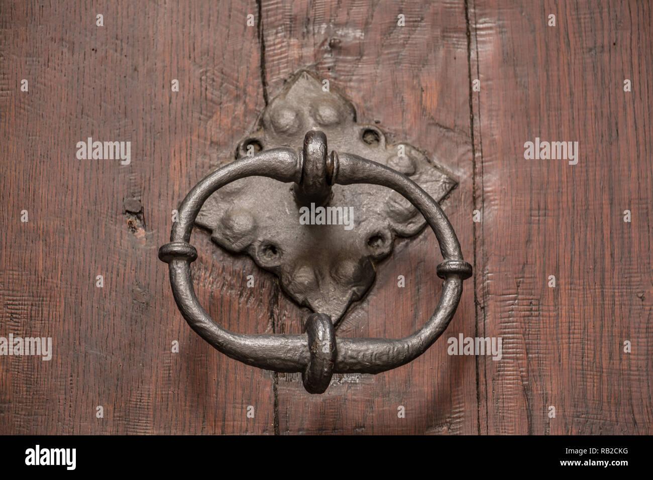 Old door of a historical building with iron door knob - Stock Image