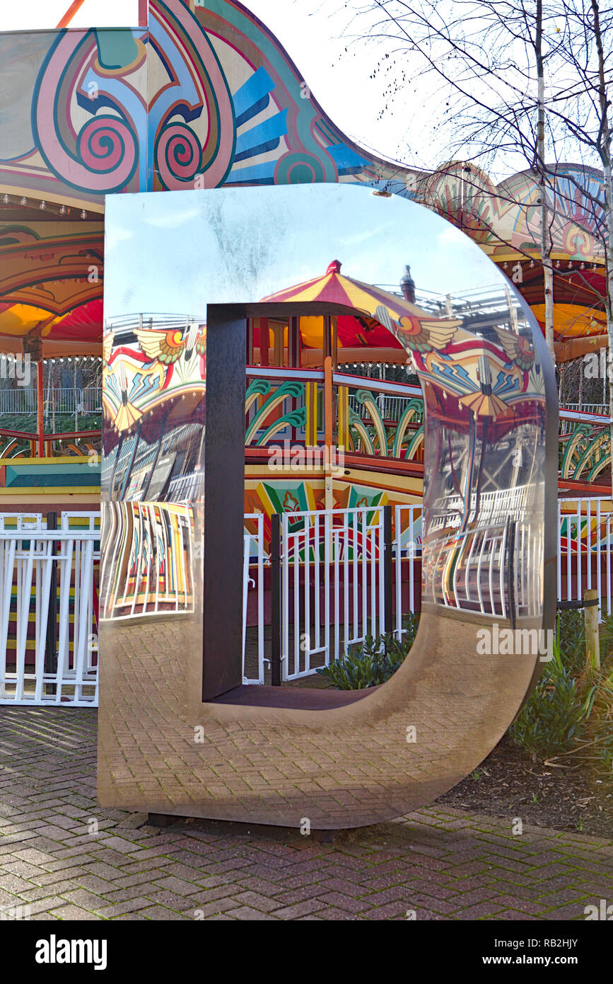 Reflection in a Shiny mirrored letter D at margate dreamland - Stock Image