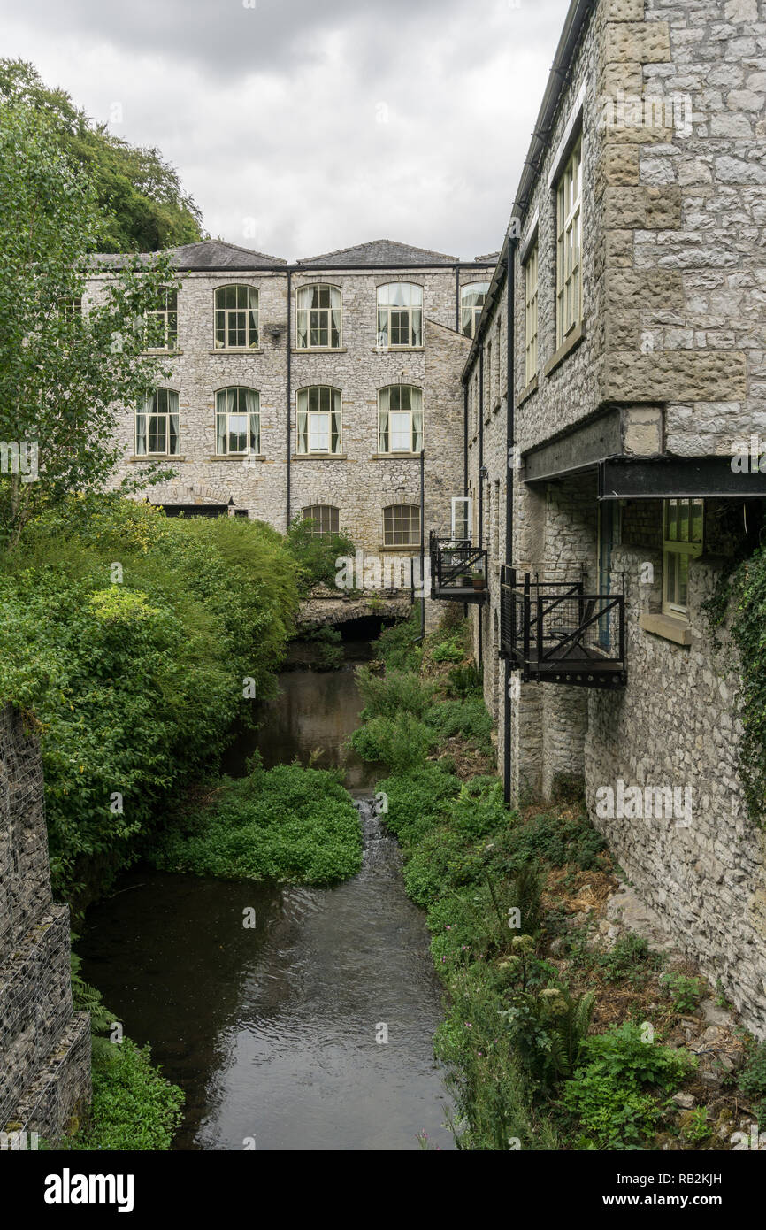 Litton Mill, a former textile factory dating from 18th century, Millers Dale, Derbyshire, UK; now converted to flats for residential use. Stock Photo