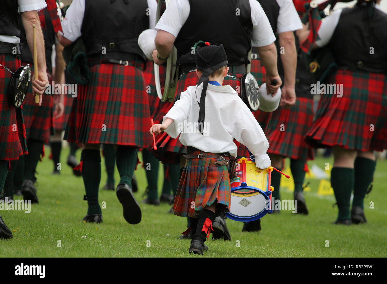 Little Boy plays the drum at Highland games Stock Photo