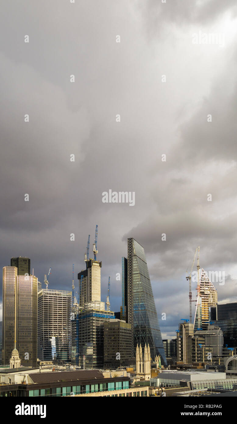 Stormy sky, City of London skyscrapers including the Cheesegrater, Tower 42 and new buildings under construction, the Scalpel and 22 & 100 Bishopsgate Stock Photo