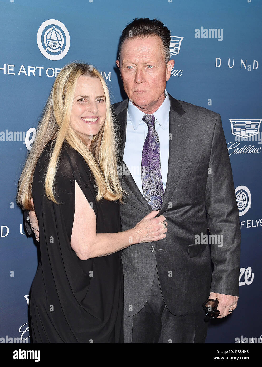 Los Angeles, USA. 5 January 2019. Barbara Patrick (L) and Robert Patrick attend Michael Muller's HEAVEN, presented by The Art of Elysium at a private venue on January 5, 2019 in Los Angeles, California. Credit: Jeffrey Mayer/Alamy Live News - Stock Image