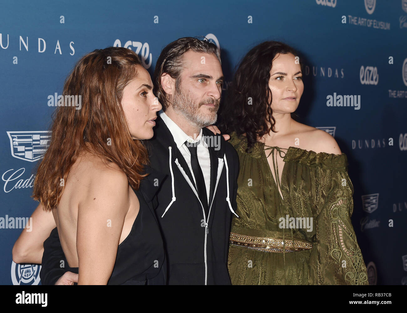 Los Angeles, United States. 05th Jan, 2019. LOS ANGELES, CA - JANUARY 05: (L-R) Summer Phoenix, Joaquin Phoenix and Rain Phoenix attend Michael Muller's HEAVEN, presented by The Art of Elysium at a private venue on January 5, 2019 in Los Angeles, California. Credit: Jeffrey Mayer/Alamy Live News - Stock Image