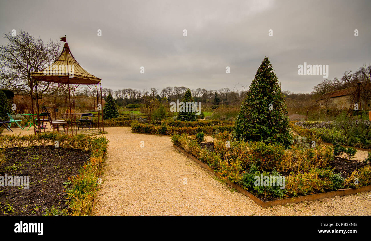 Walled garden behind the cottages next to the ruins of Cowdray House, Midhurst, West Sussex, UK - Stock Image