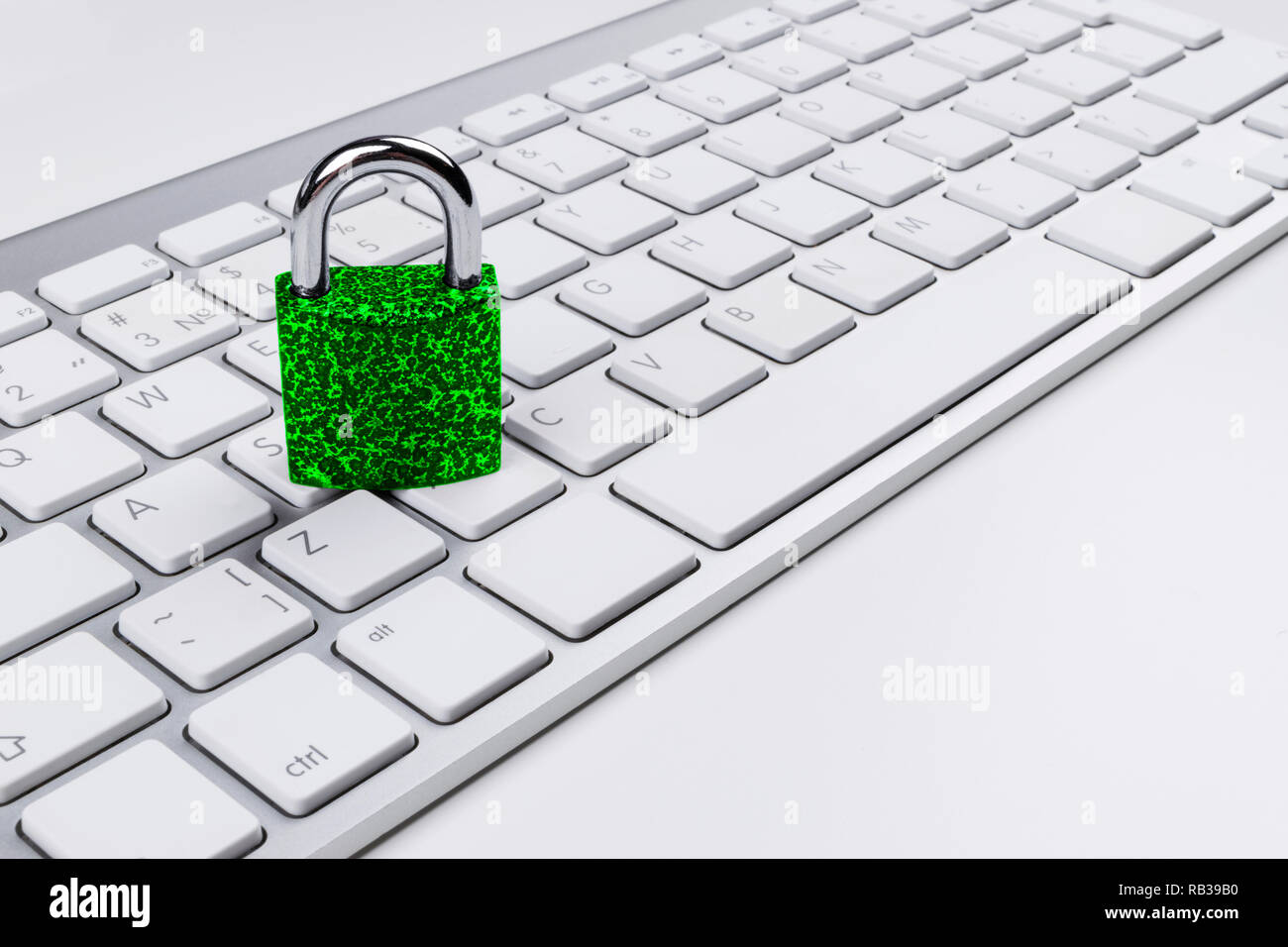 Locked computer safe from virus or malware attack. Laptop computer being protected from online cyber crime and hacking. Computer security concept with Stock Photo