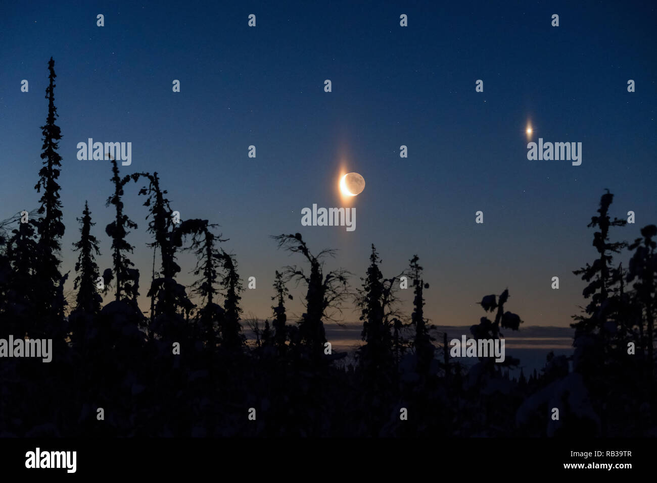 Venus and cressent moon seen in Lapland, Finland, Europe - Stock Image