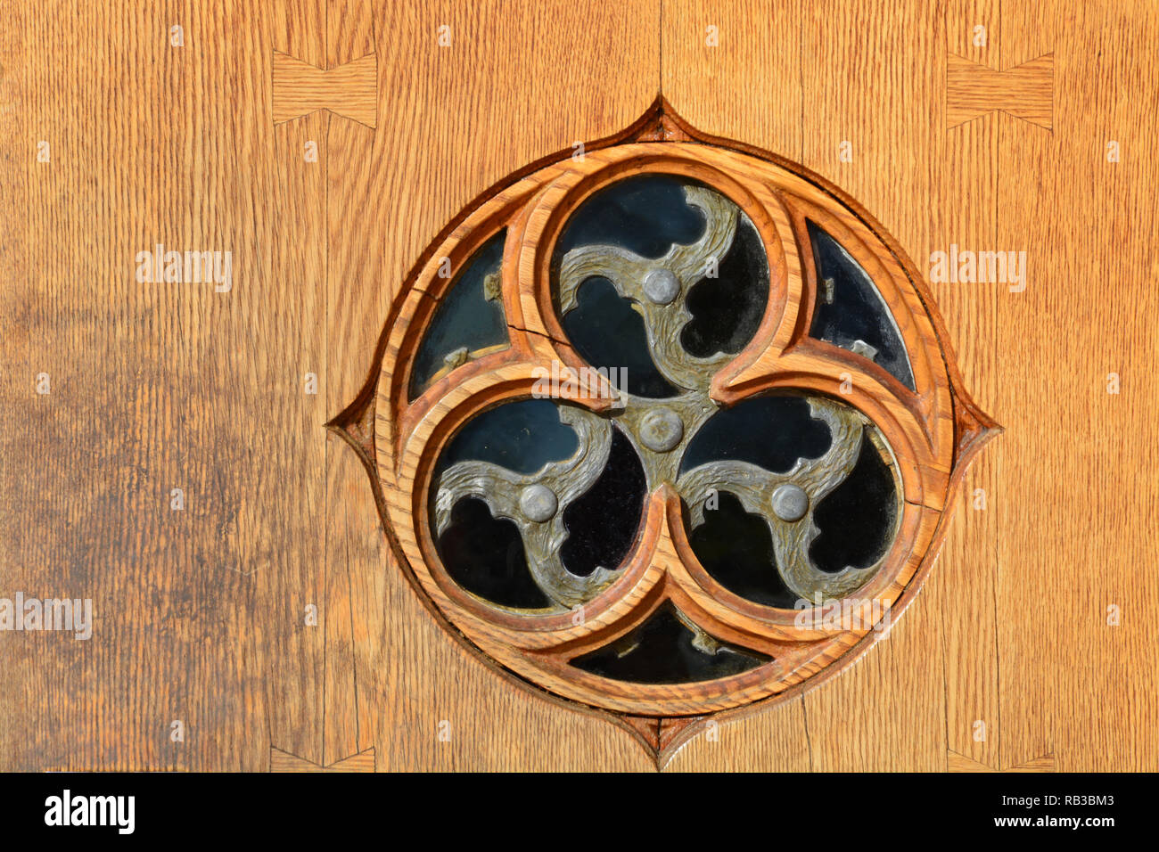 A round window in the door to the Duke University Chapel in Durham North Carolina. Stock Photo