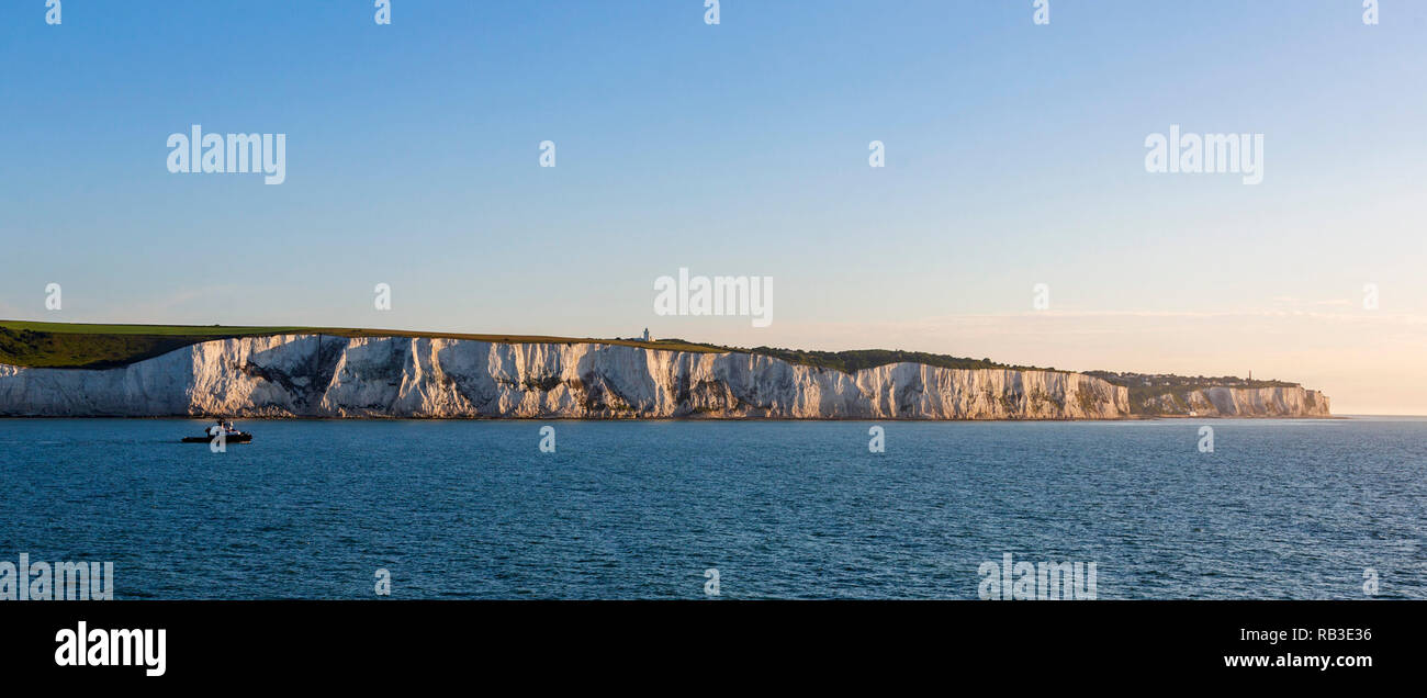 Ship in front of the White Cliffs of Dover in the morning light, Kent, England, United Kingdom - Stock Image