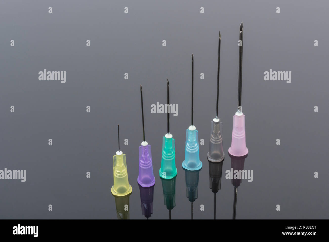 Close-up of hypodermic needles. Specifically BD Microlance brand (see Add. Info). Metaphor NHS, innoculation, flu jab, business cash injection, sharp. - Stock Image