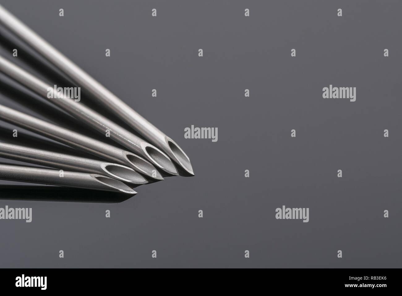 Macro close-up hypodermic needle tips. BD Microlance 18 Gauge 1 1/2' 1.2/40mm Pink. Metaphor NHS, innoculation, flu jab, sharp point, abstract needle. - Stock Image