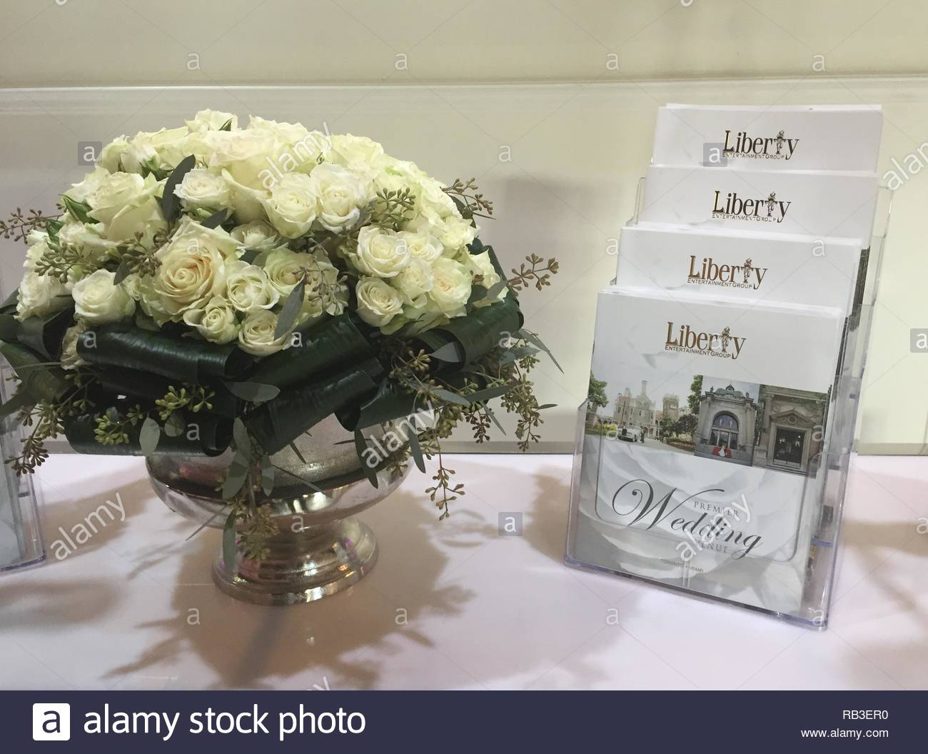 Flowers by brochures for wedding planning in Toronto, Ontario, Canada. - Stock Image