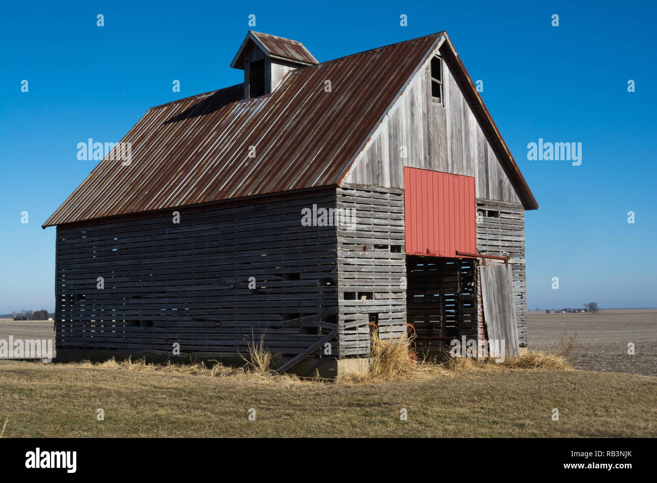 Old wooden barn in the rural open farmland.  Illinois, USA Stock Photo