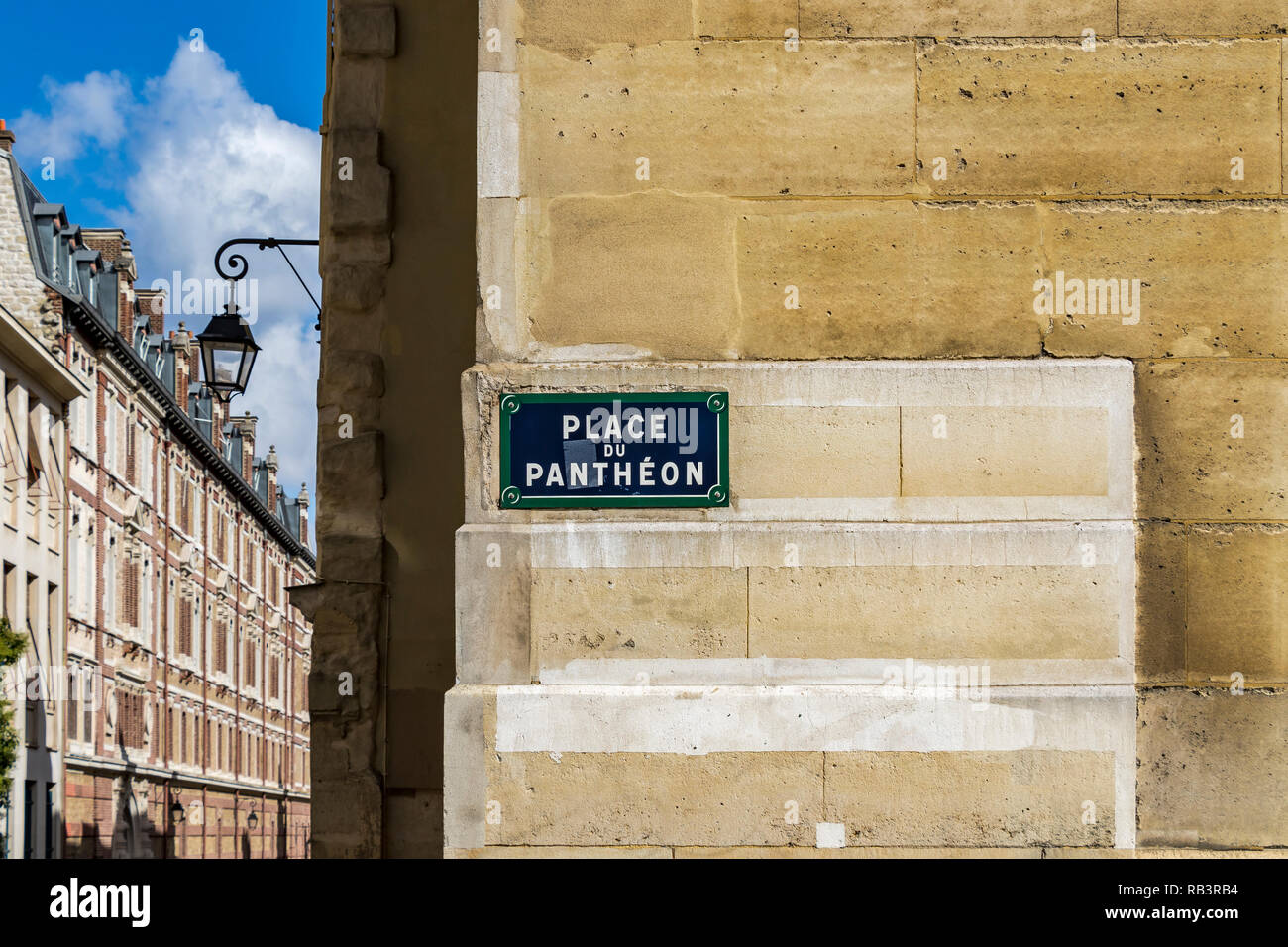 Place du Pantheon blue street sign on a yellow stone wall near The Pantheon ,Paris - Stock Image