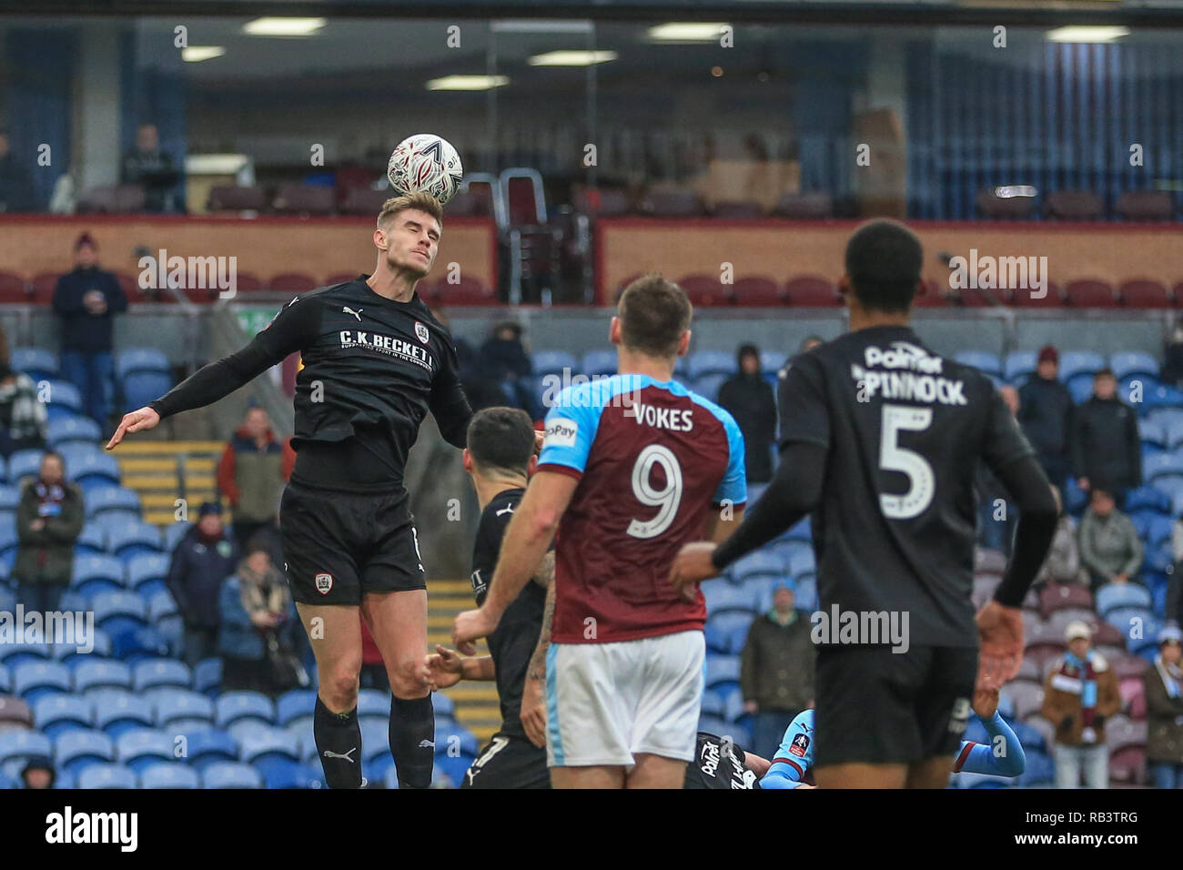5th January 2019, Turf Moor, Burnley, England ; The Emirates FA Cup, 3rd Round, Burnley vs Barnsley : Liam Lindsay (06) of Barnsley heads the ball clear from a corner   Credit: Mark Cosgrove/News Images  English Football League images are subject to DataCo Licence - Stock Image