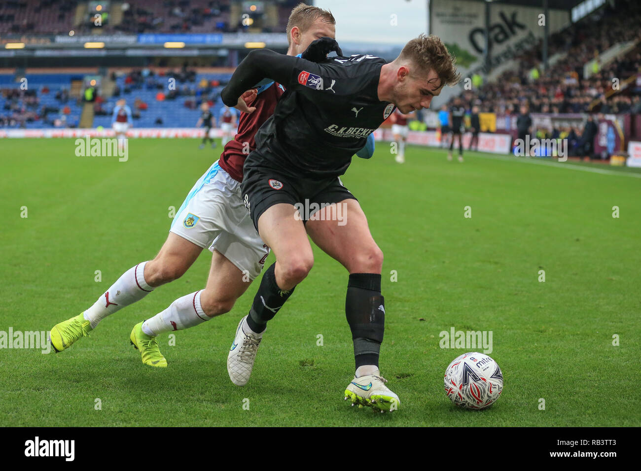 5th January 2019, Turf Moor, Burnley, England ; The Emirates FA Cup, 3rd Round, Burnley vs Barnsley : Liam Lindsay (06) of Barnsley holds off Charlie Taylor of Burnley   Credit: Mark Cosgrove/News Images  English Football League images are subject to DataCo Licence - Stock Image