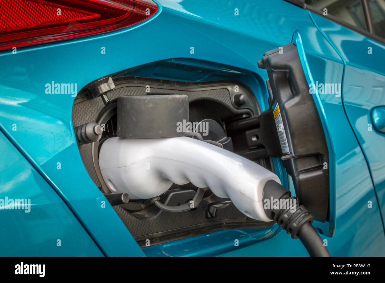 Electric car on charge - Stock Image