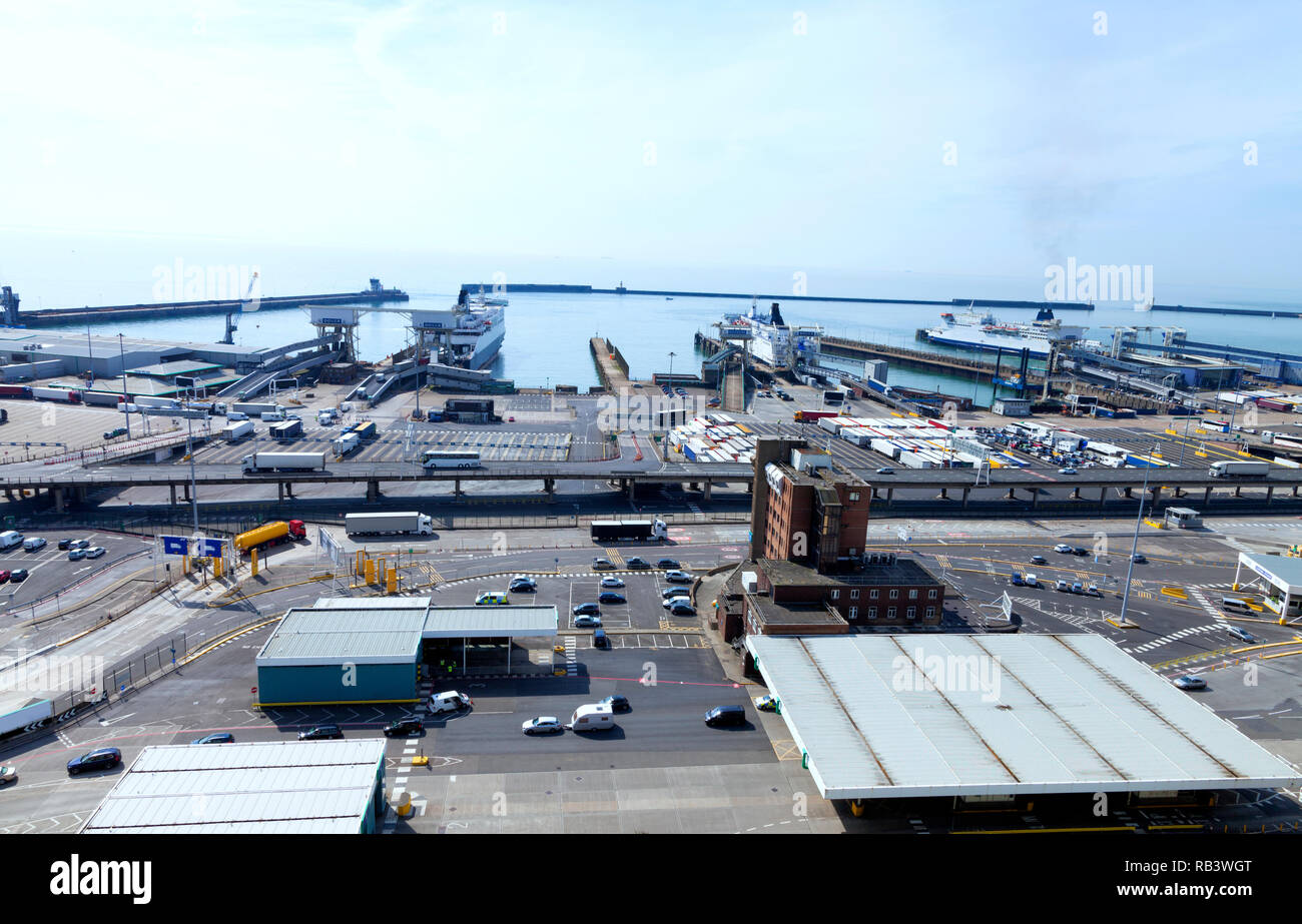 Busy Port of Dover docks . Cars and trucks with cargo queuing to embark ferry for channel crossing . - Stock Image