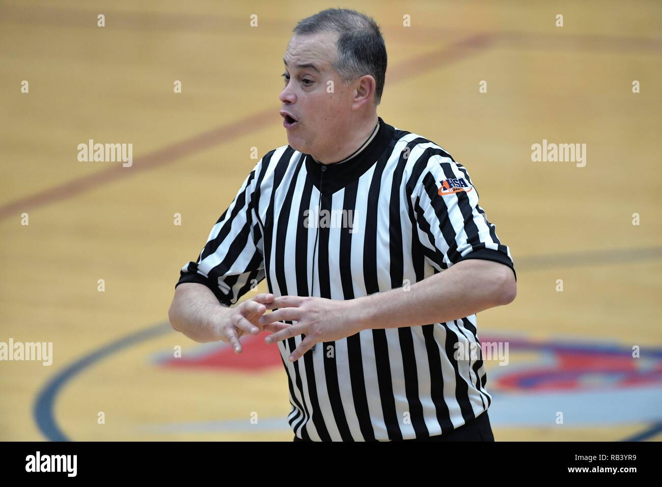 South Elgin, Illinois, USA, Official communicating the results of a call to the scorer's table. - Stock Image