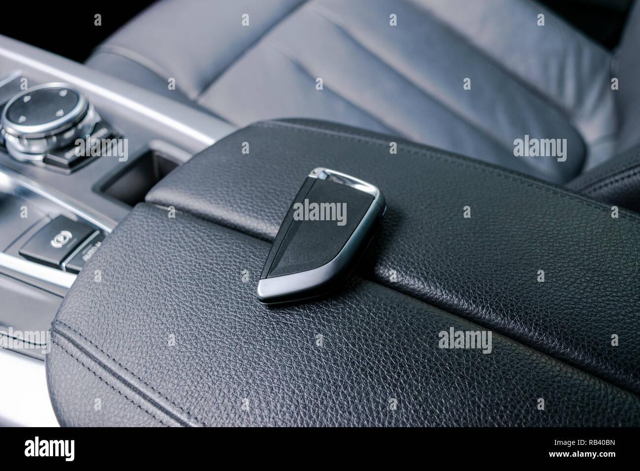 Closeup inside vehicle of wireless key ignition  Start