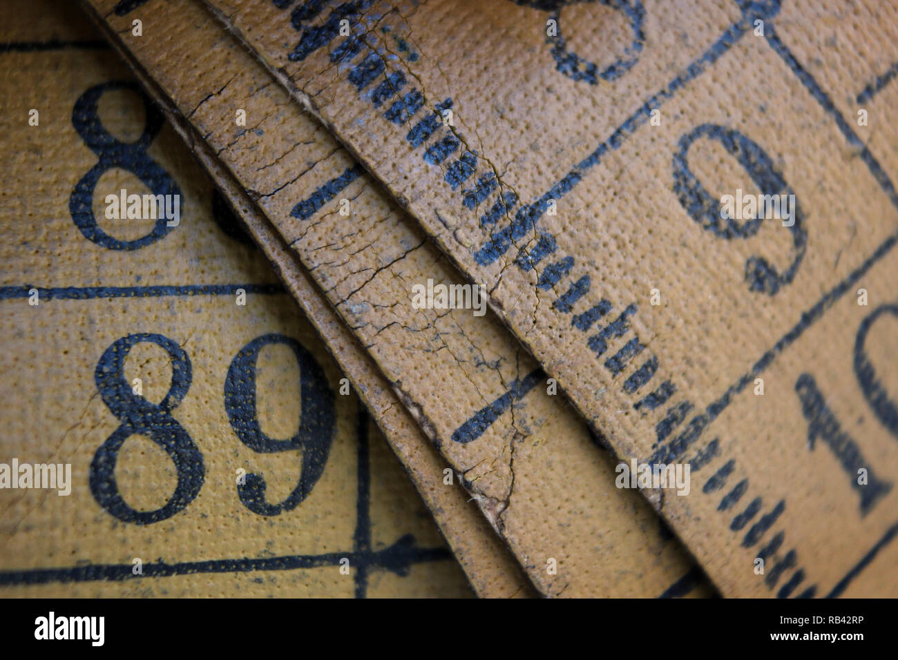 Old measuring tape isolated on white background, close-up - Stock Image