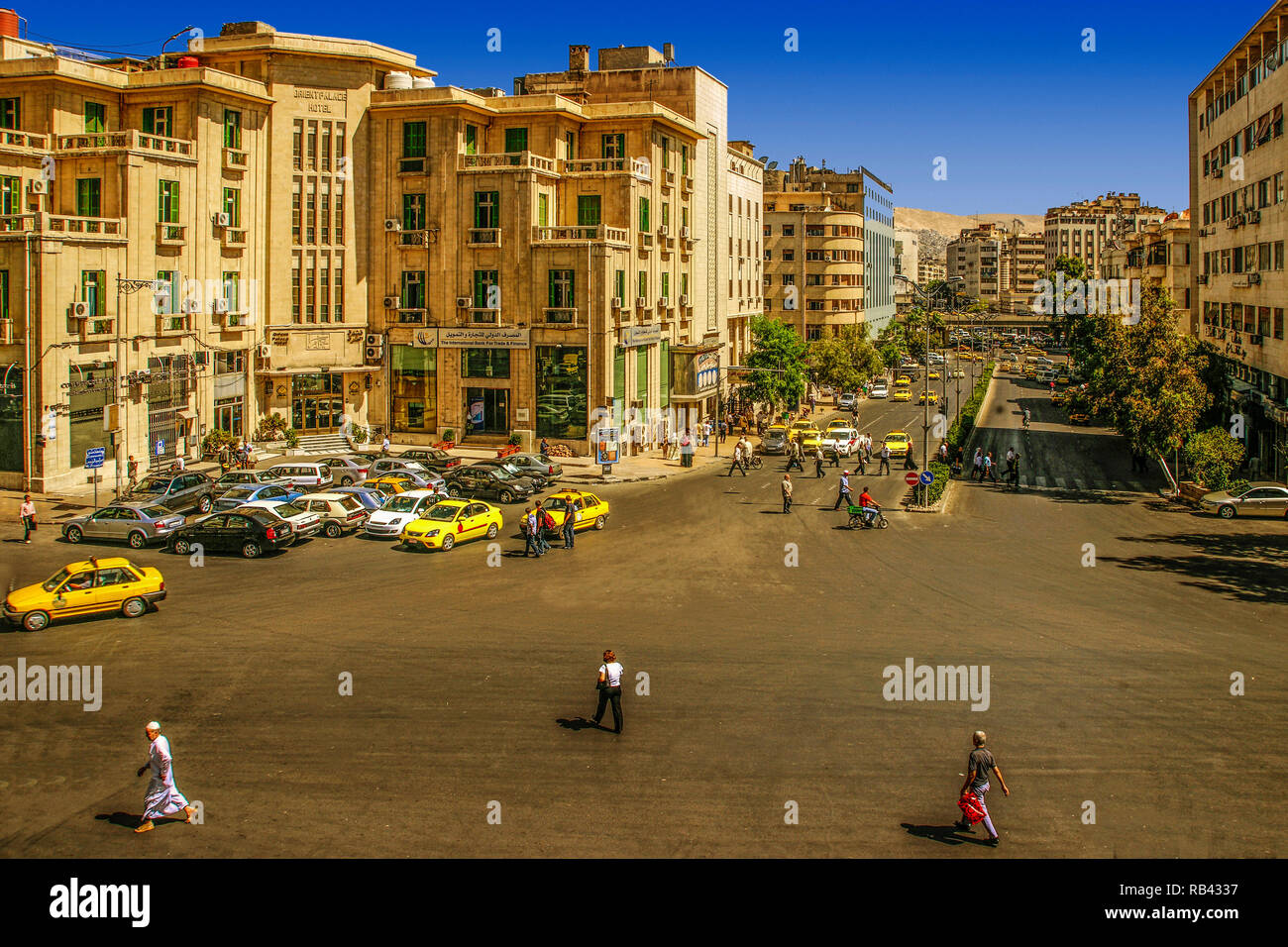 Modern city by the Hedjaz railway station, and the famed Orient Palace Hotel. Damascus. Syria, Middle East - Stock Image