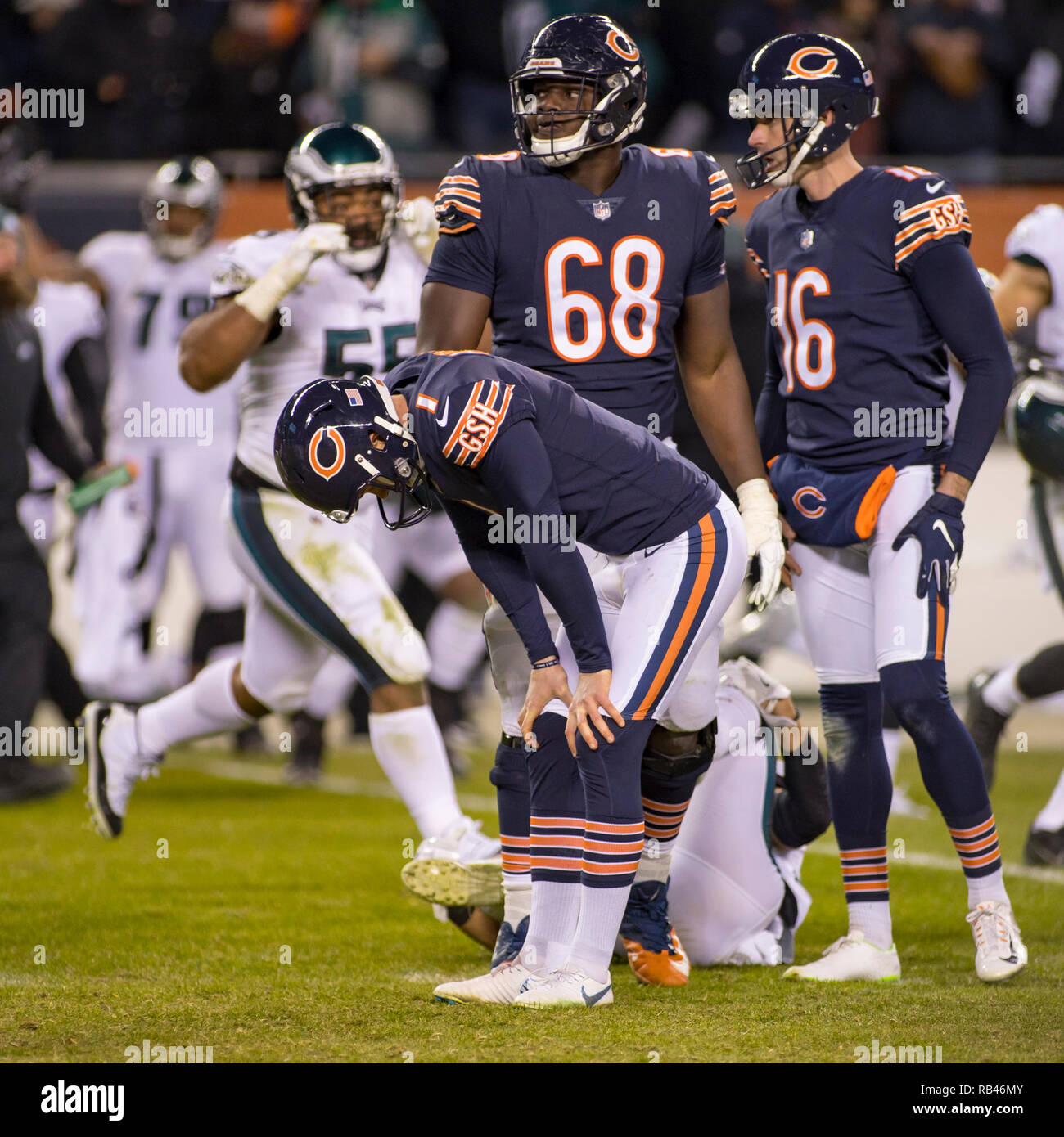 Chicago, Illinois, USA. 06th Jan, 2019. - Bears Kicker #1 Cody Parkey, #68 James Daniels and #16 Pat O'Donnell react after missing the game winning field goal during the NFL Playoff Game between the Philadelphia Eagles and Chicago Bears at Soldier Field in Chicago, IL. Photographer: Mike Wulf Credit: csm/Alamy Live News - Stock Image
