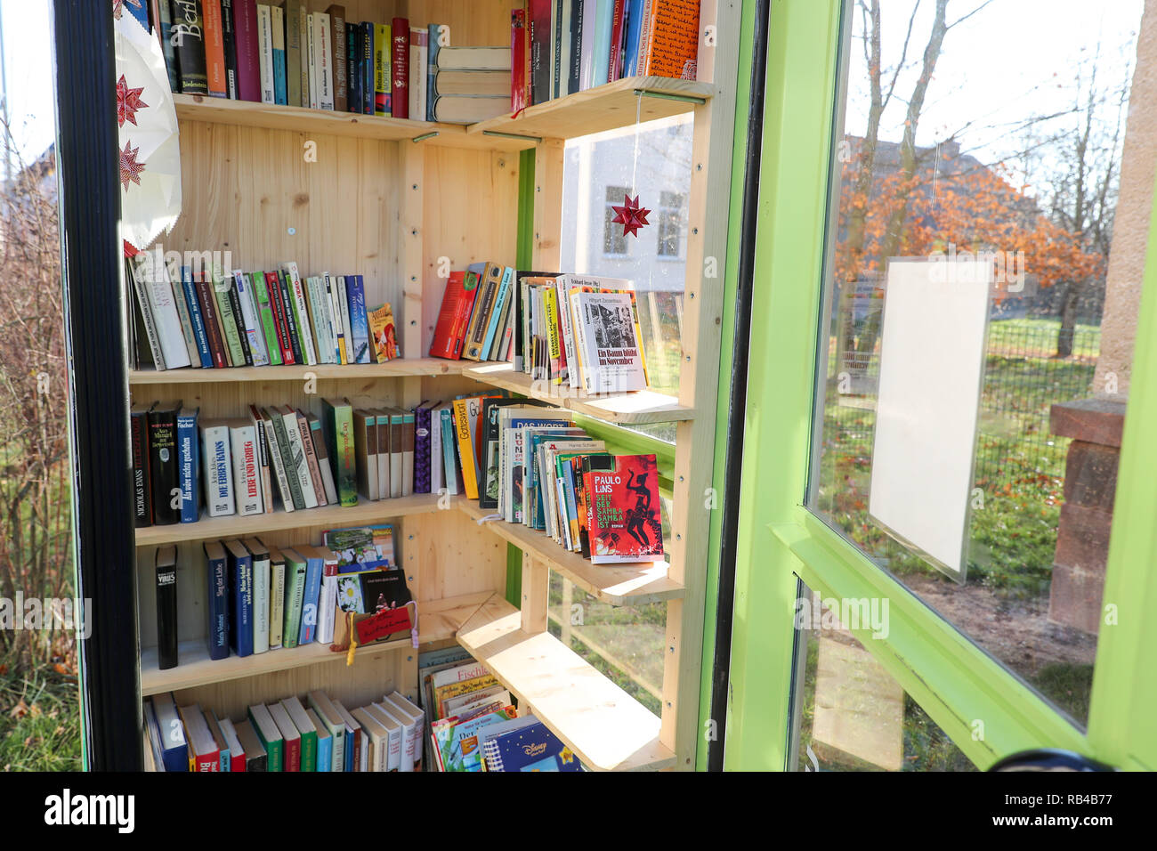 Waldenburg, Germany. 28th Nov, 2018. A former telephone booth now serves as a bookstore in Waldenburg. Books can be borrowed free of charge in the open bookcase. The idea thrives on people posting their own, no longer needed books here. Credit: Jan Woitas/dpa-Zentralbild/dpa/Alamy Live News - Stock Image
