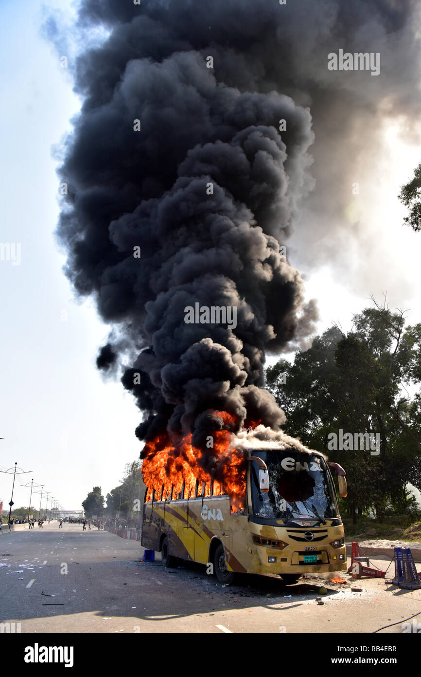 Dhaka, Bangladesh. 07th Jan, 2019. Dhaka, Bangladesh - January 07, 2019: Garment workers set fire to a bus on the key Airport road in Dhaka during a demonstration to demand an increase in the minimum wage and to press for a series of other demands, Dhaka, Bangladesh. Credit: SK Hasan Ali/Alamy Live News - Stock Image