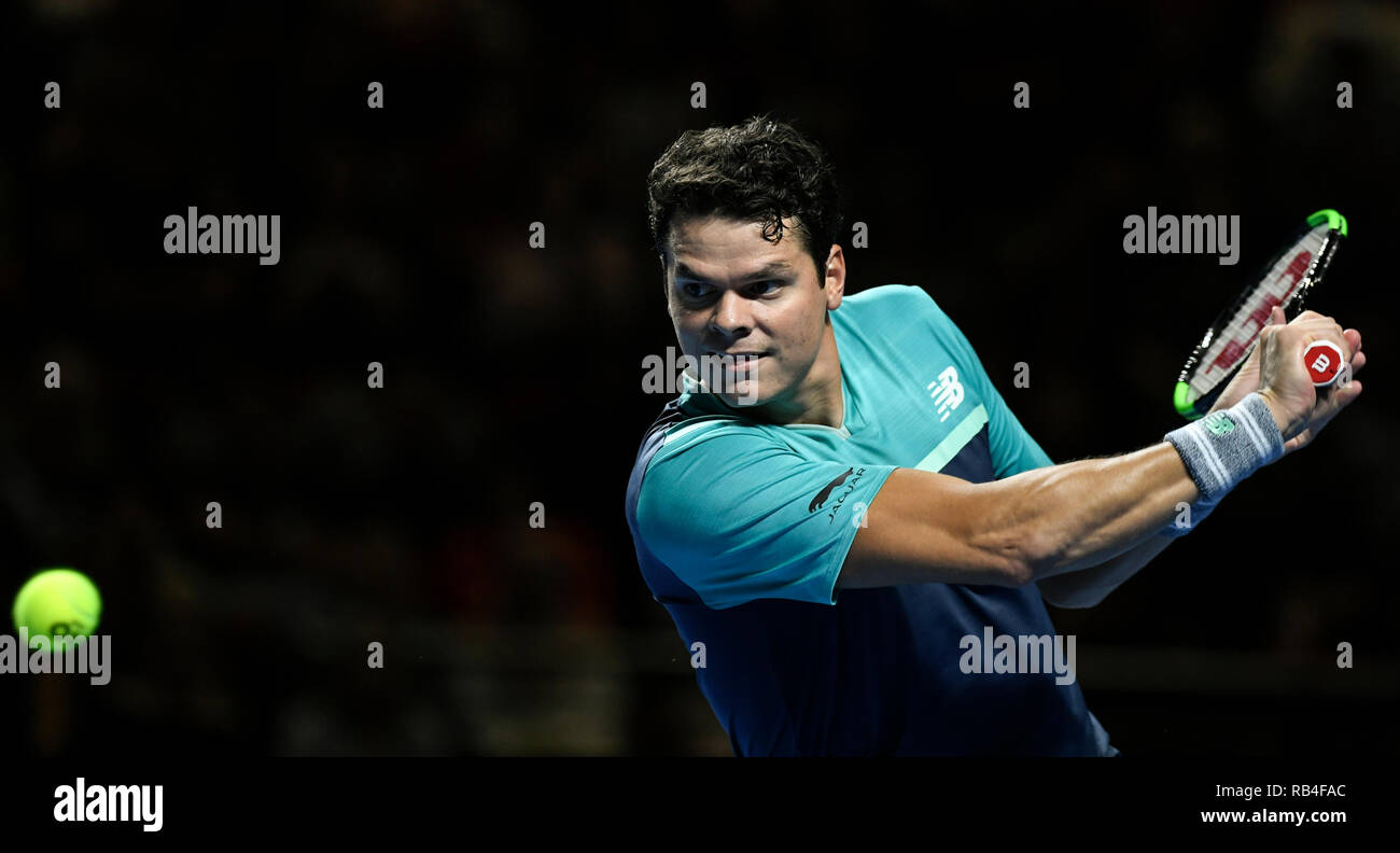 Qudos Bank Arena, Sydney, Australia. 7th Jan, 2019. Fast4 Tennis Showdown; Milos Raonic of Canada hits a backhand to John Millman of Australia Credit: Action Plus Sports/Alamy Live News - Stock Image