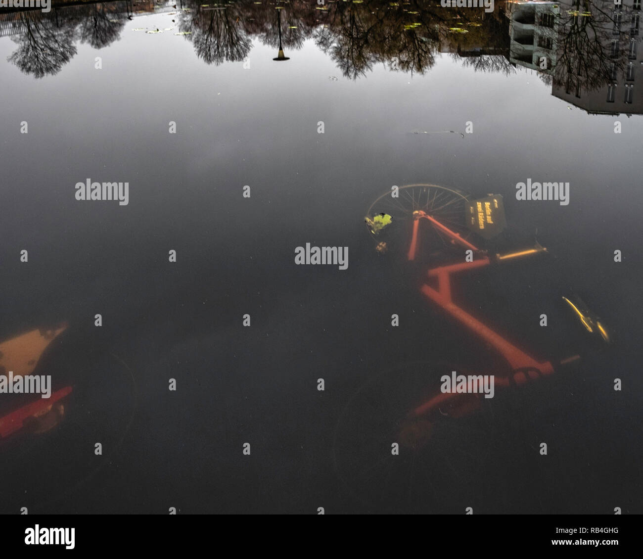 Mitte, Berlin, Germany. Rental Bicycles line the bottom of the Volkspark am Weinberg.the work of vandals or a protest by local citizens objecting to the bicycles blocking pavements Stock Photo