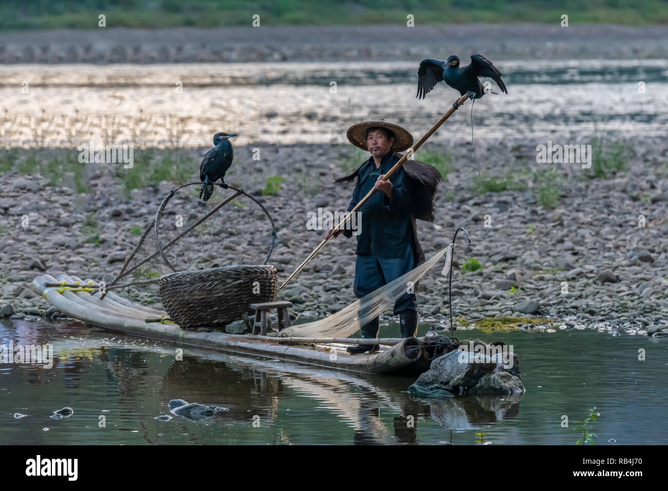 Cormorant Fisherman on the Lijiang River, china - Stock Image
