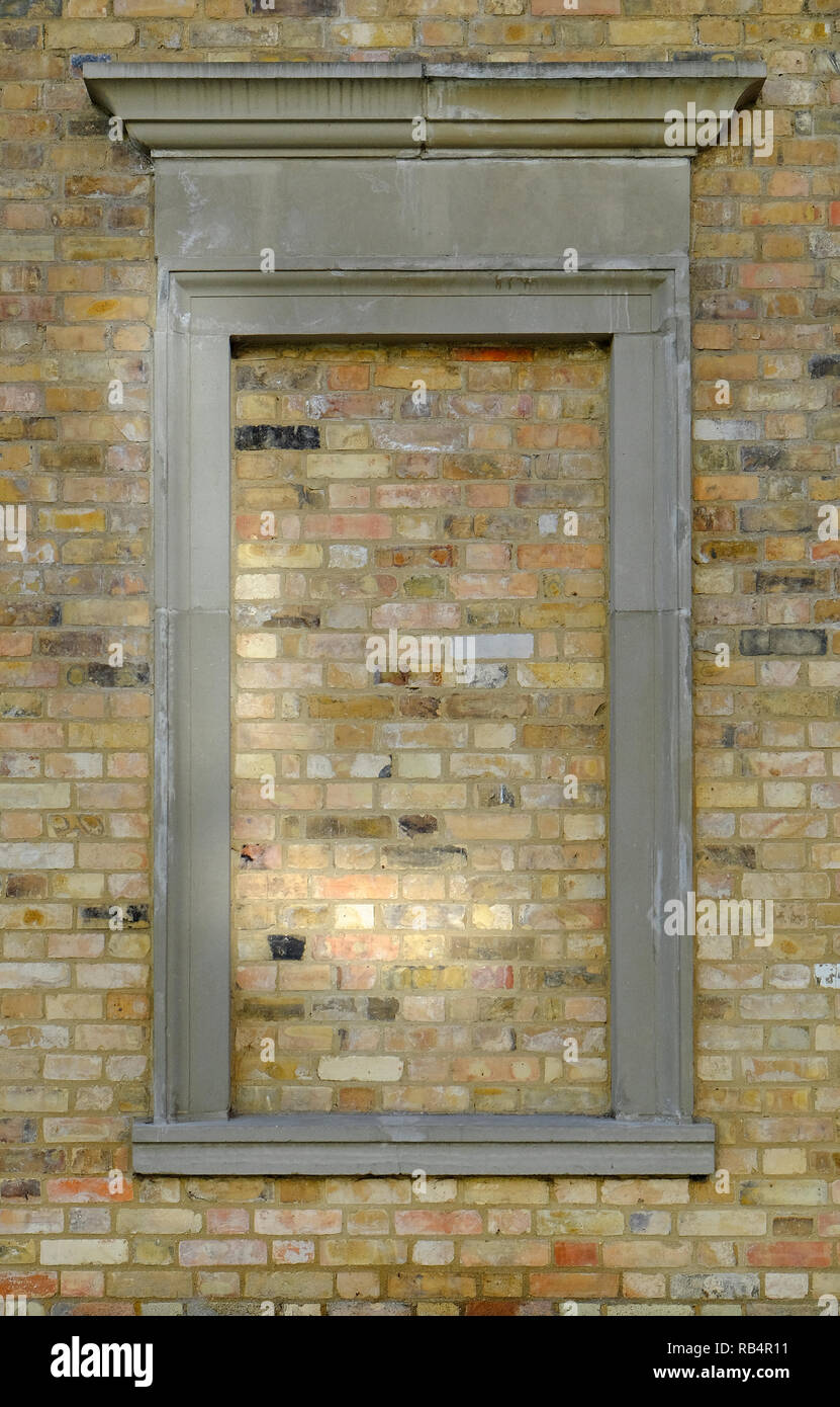 bricked in window a classical architectural style feature - Stock Image