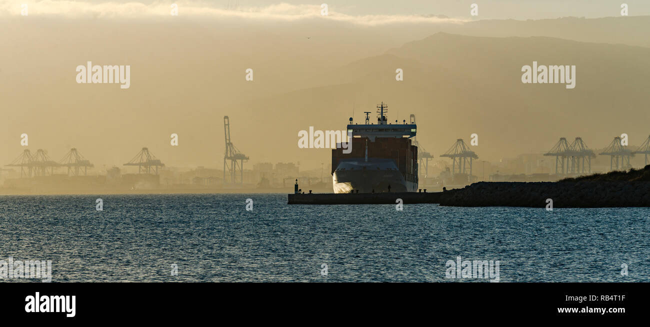 Container ship in port of Algeciras, at the Strait of gibraltar, Algeciras, Andalusia, Spain - Stock Image