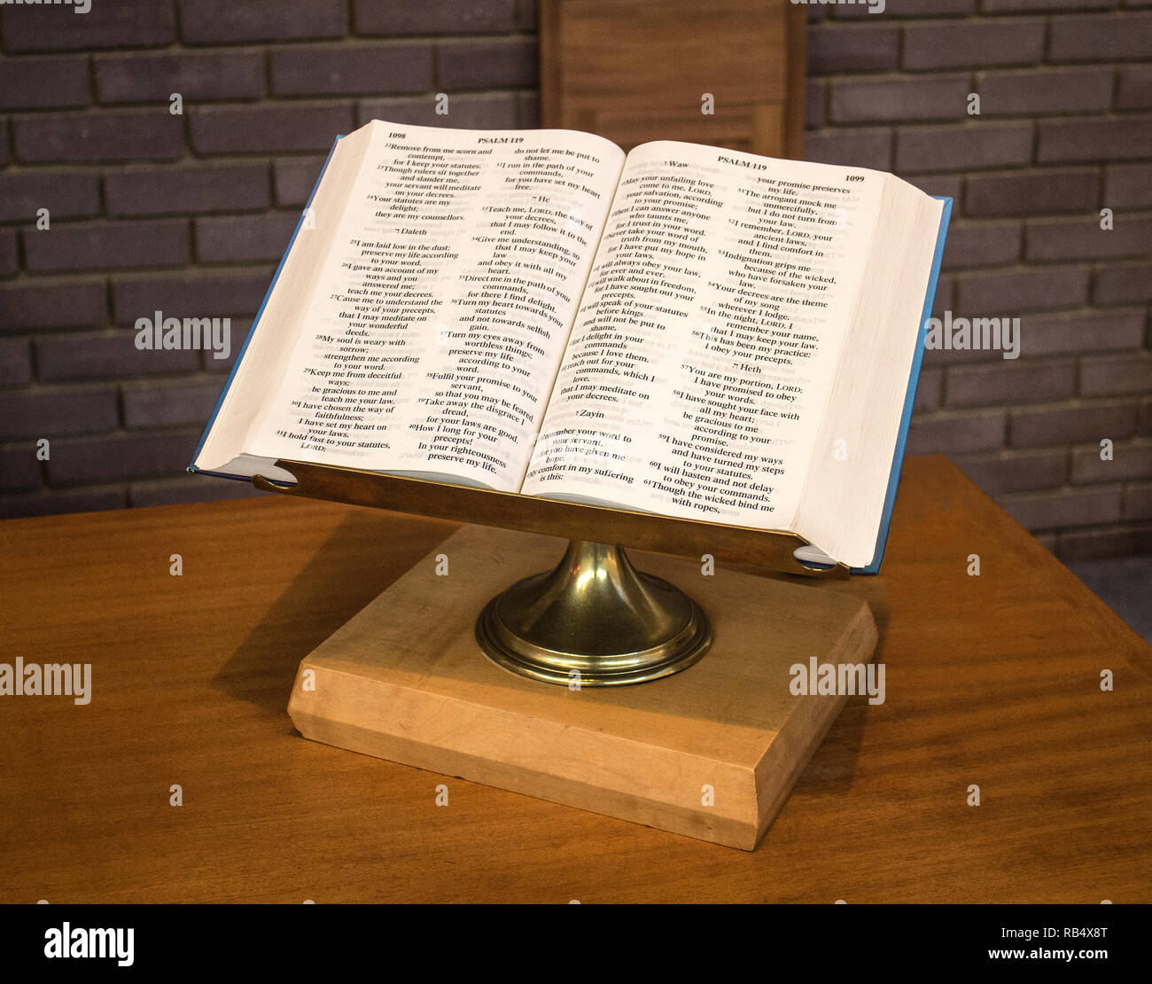 An open English Bible on a lectern in a church - Stock Image