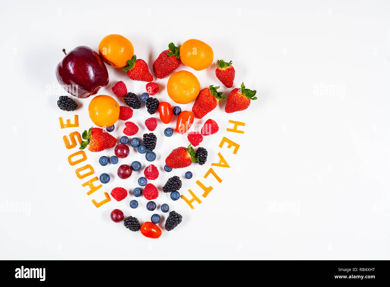 Heart shaped fruit arrangement with Choose Health message in it made out of tangerine peels in a clean white background with copy space. - Stock Image
