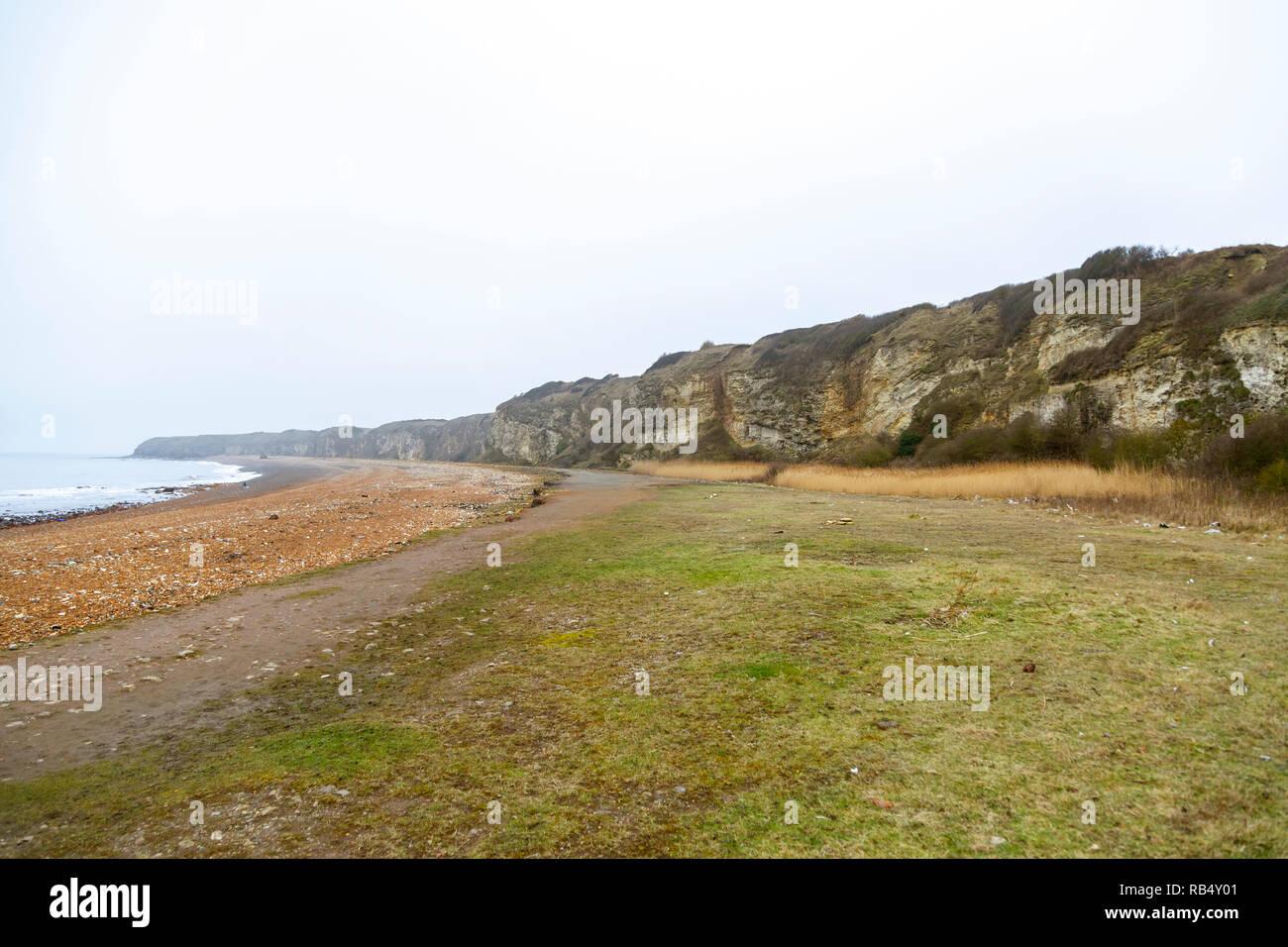 Cliffs and beach at Blast Beach, Seaham, County Durham - Stock Image