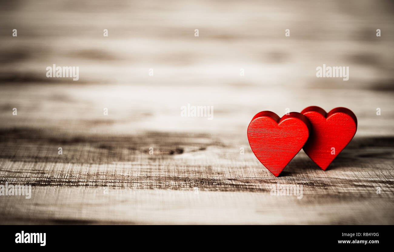 Valentine's Day greeting. Heart on a wooden board with shalow depth of field. 3d rendering illustration - Stock Image
