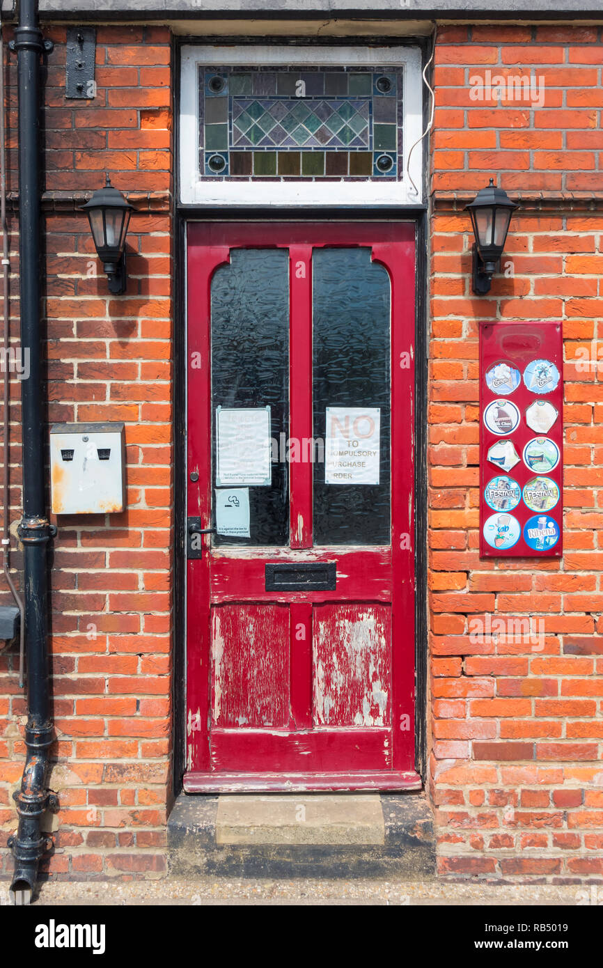 Door of White Hart Inn pub, Isle of Wight, near the East Cowes Ferry terminal, Hampshire, UK, with protest notice saying 'No to Compulsory Purchase' - Stock Image