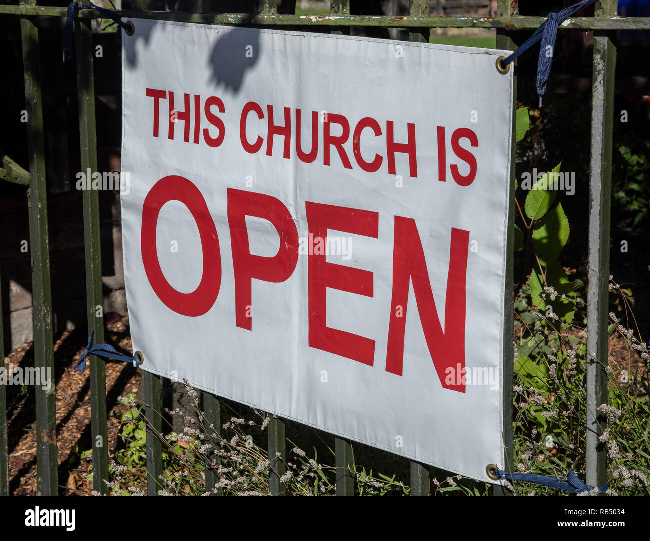Church open sign outside an Anglican church in Port Sunlight, Wirral Stock Photo