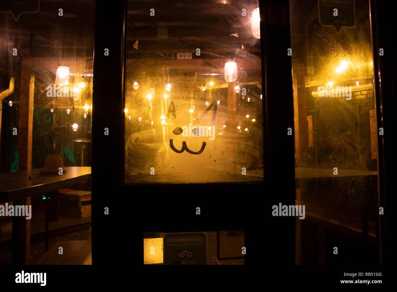A welcoming entrance to restaurant - Stock Image