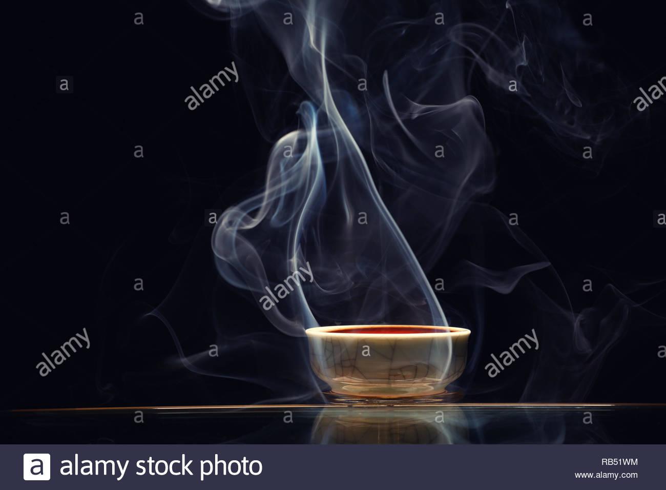 Chinese black tea cup smoke dark background nobody Stock