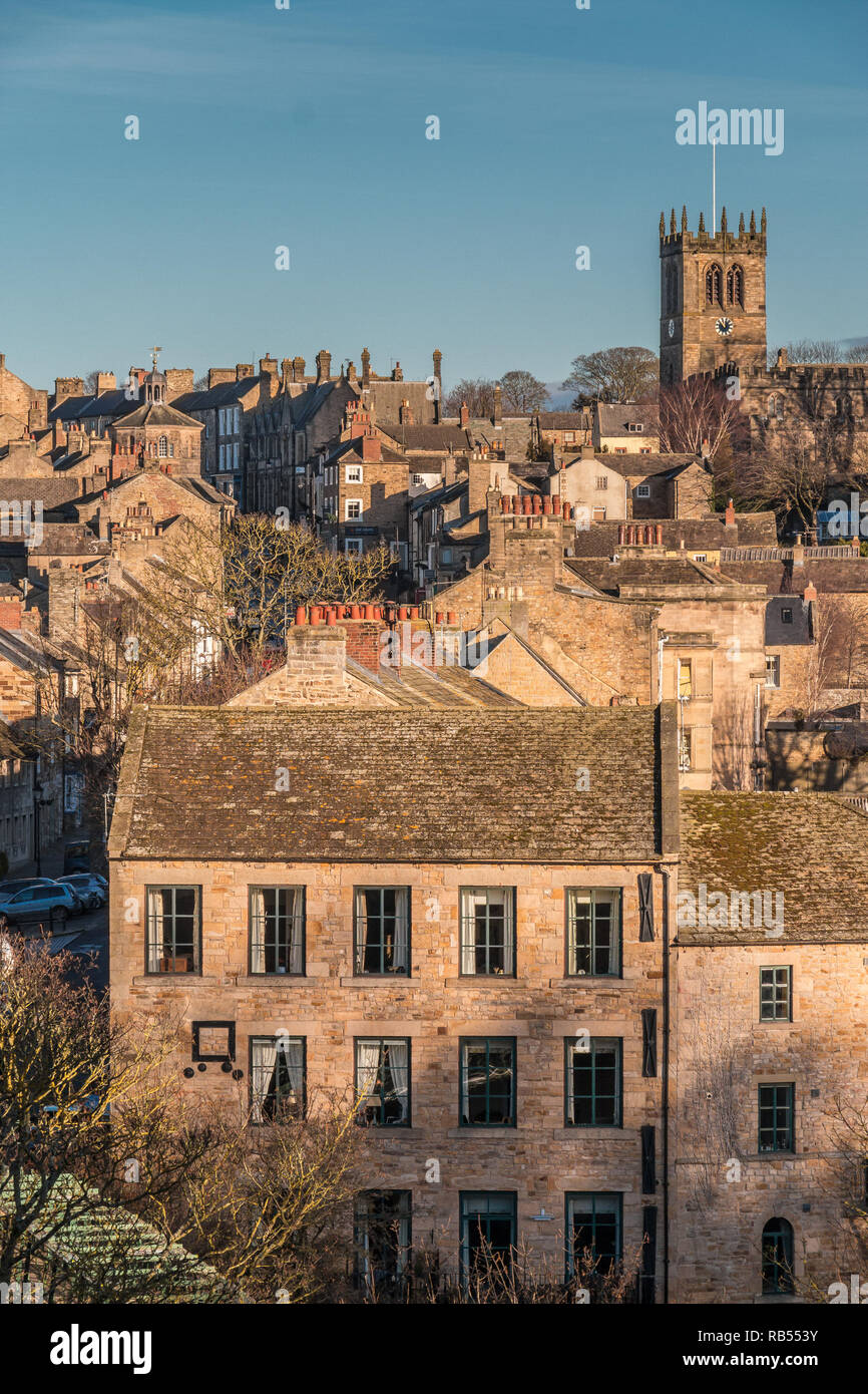 Barnard Castle, Teesdale, County Durham, UK roofscape in strong winter sunshine and a clear blue sky, with copy space Stock Photo