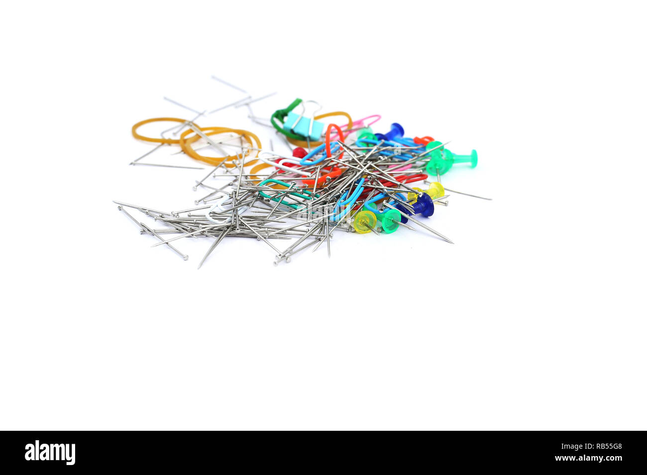 Picture of colorful paper pin and rubber band. Isolated on the white background. - Stock Image